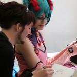 Cosplayer und Mangazeichner unter sich